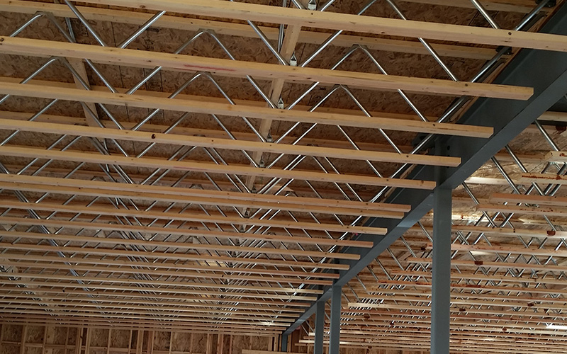 roof made of wooden and metal beams