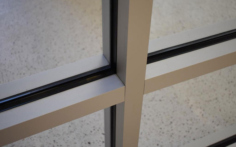 close up of the metal molding on a window