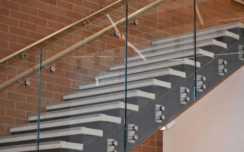 metal staircase with a glass wall rail